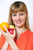 Young woman is beautiful healthy wields lot of fruit. Royalty Free Stock Photos