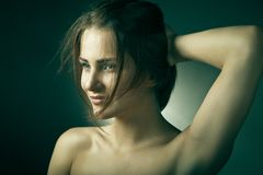 Young woman with beautiful long brown hairs Royalty Free Stock Images