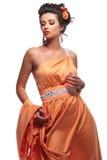 Young woman in a beautiful long dress posing Stock Photography