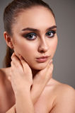 Young woman with beautiful make-up. Stock Image