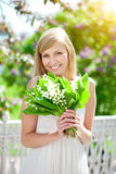 Young woman with a beautiful smile with healthy teeth with flowe Royalty Free Stock Images