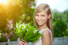 Young woman with a beautiful smile with healthy teeth with flowe Stock Photo