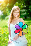 Young woman with a beautiful smile with healthy teeth with flowe Stock Images
