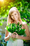 Young woman with a beautiful smile with healthy teeth with flowe Royalty Free Stock Photography