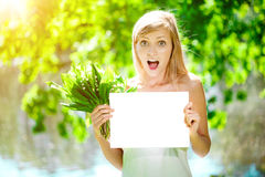 Young woman with a beautiful smile with healthy teeth with flowe Stock Photos