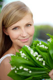 Young woman with a beautiful smile with healthy teeth with flowe Stock Image