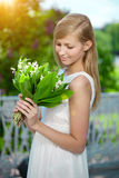 Young woman with a beautiful smile with healthy teeth with flowe Royalty Free Stock Image