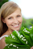 Young woman with a beautiful smile with healthy teeth with flowe Stock Photography
