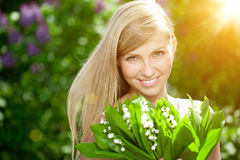 Young woman with a beautiful smile with healthy teeth with flowers. Face of a beautiful positive girl Concept on the subject. Of dentistry, stomatology, dental royalty free stock image