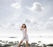 A young woman on a beautiful summer background Royalty Free Stock Images