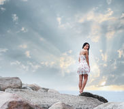 A young woman on a beautiful sunset background Royalty Free Stock Photography