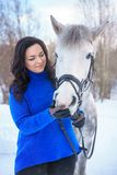 A young woman with a beautiful winter white horse stock photos