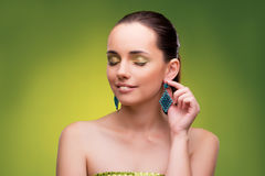 The young woman in beauty concept on green background Royalty Free Stock Photos