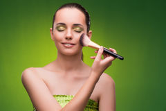 The young woman in beauty concept on green background Royalty Free Stock Image