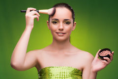 The young woman in beauty concept on green background Stock Images