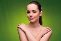 The young woman in beauty concept on green background Stock Photography
