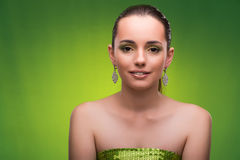The young woman in beauty concept on green background Royalty Free Stock Photography