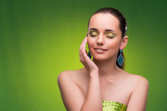 The young woman in beauty concept on green background Stock Photos