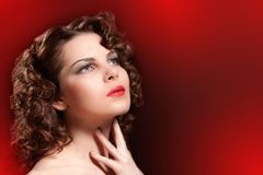 Young woman with beauty curly hairs Stock Photo