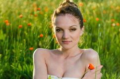 Young Woman beauty in poppy field Royalty Free Stock Image