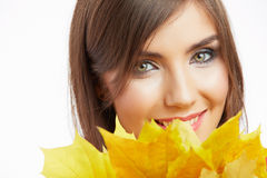 Young woman beauty portrait  with autumn leaves. Royalty Free Stock Images