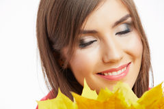 Young woman beauty portrait  with autumn leaves. Stock Photos