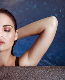 Young woman beauty portrait in water during rainy evening Royalty Free Stock Photo