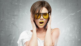 Young woman beauty portrait with yellow sun glasse Royalty Free Stock Images
