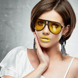 Young woman beauty portrait with yellow sun glasses. Royalty Free Stock Image