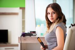 The young woman in the beauty salon royalty free stock photos