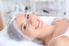 Young woman at beauty salon. Cosmetic procedures Royalty Free Stock Photos