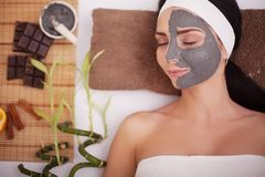 Young woman in beauty salon having face mask.  royalty free stock image