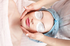 Young woman beauty treatment - facial massage Stock Photo