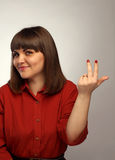 Young woman beckoning gesture to her Royalty Free Stock Photography