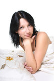 Young woman on bed Stock Images