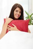 Young woman on bed Royalty Free Stock Photos