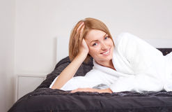 Young woman on the bed Stock Photos