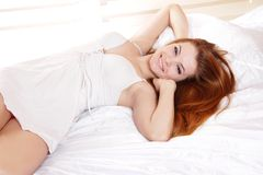 Young woman in bed Stock Photography