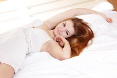 Young woman in bed Royalty Free Stock Images