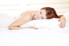 Young woman in bed Stock Photo