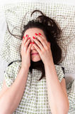 Young woman in the bed. In bright light Royalty Free Stock Photos