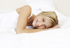 Young woman in bed royalty free stock photography