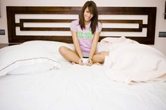 Young woman in bed Stock Image