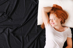 A young woman in bed Stock Images