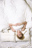 Young woman in bed Royalty Free Stock Image
