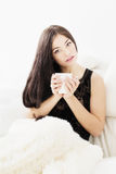 Young woman in bed with a cup of coffee Royalty Free Stock Photos