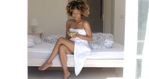 Young Woman On Bed Eating Vegetable Salad Stock Image