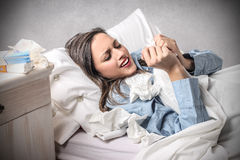 Young woman into bed with the flu Stock Image
