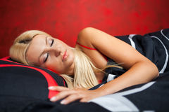 Young woman in bed in red underwear Royalty Free Stock Photos