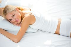 Young woman at bedroom Royalty Free Stock Images
